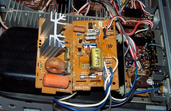 The control board with the exploded capacitor